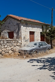 Old building with dust covered car