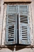 Old doors of houses in Syros. Greek Islands