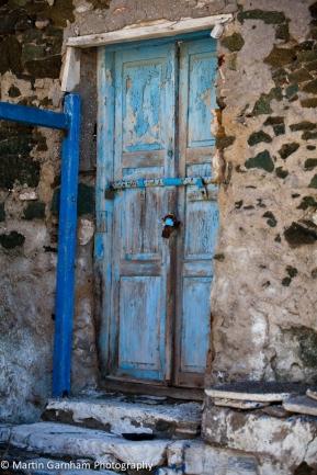 Old doors of houses in Syros