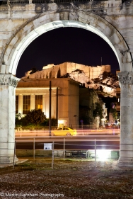 The Arch of Hadrian with The Acropolis in the background taken at Night in Athens, Greece.