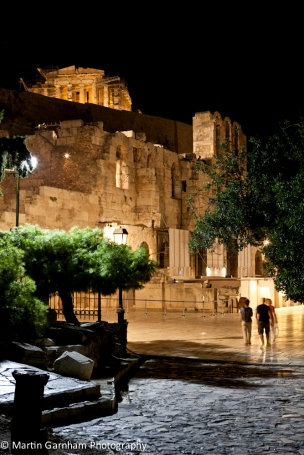Odeon of Herodes Atticus amphitheater with the Parthenon in the background in Athens, Greece.