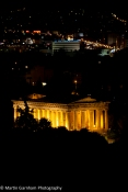 The Temple of Hephaestus at night in The Agora of Athens in Athens, Greece.